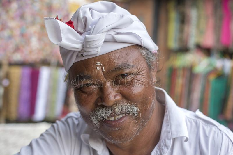 Portrait indonesian man in a gift shop next to the rice terraces of Tegallalang in Bali, Indonesia stock photo