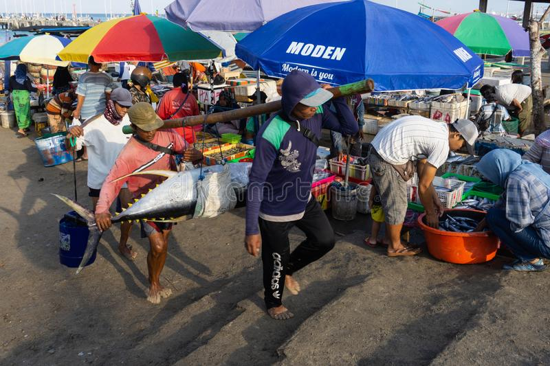 BALI/INDONESIA-MAY 15 2019: the atmosphere of the Kedonganan-Bali fish market with colorful umbrellas at each kiosk. Some stock images