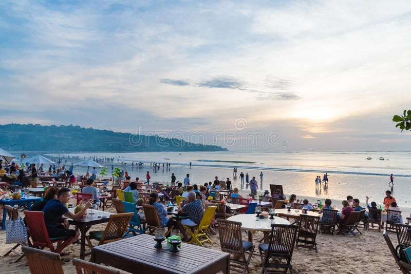 Sea food restaurants on Jimbaran beach in Bali, Indonesia. Bali, Indonesia - May 12, 2017: Jimbaran tropical beach is a main popular balinese attraction, famous stock images