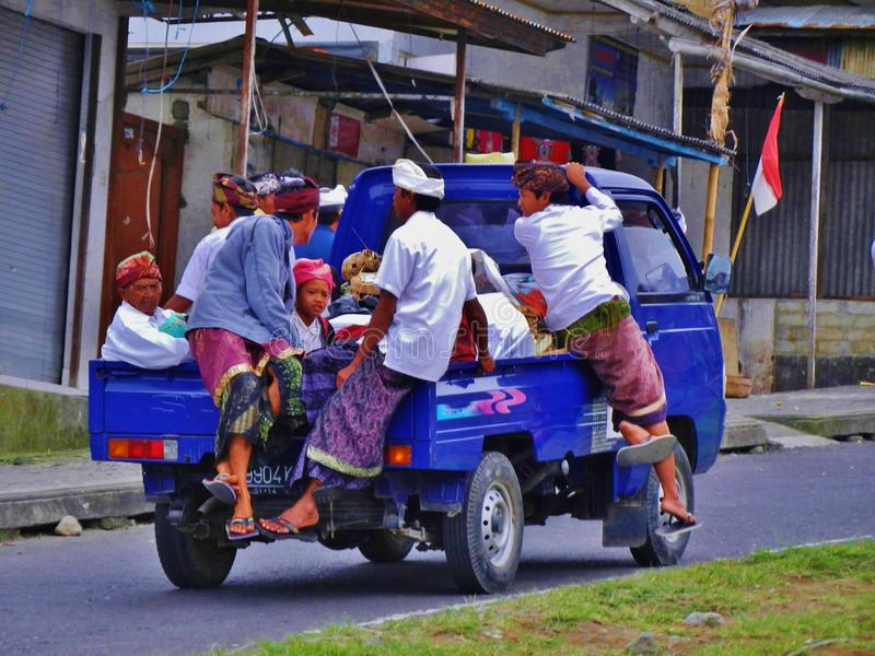 Bali island 003. Happy local children in national costume riding a ceremony in the truck, bali island, indonesia royalty free stock photos