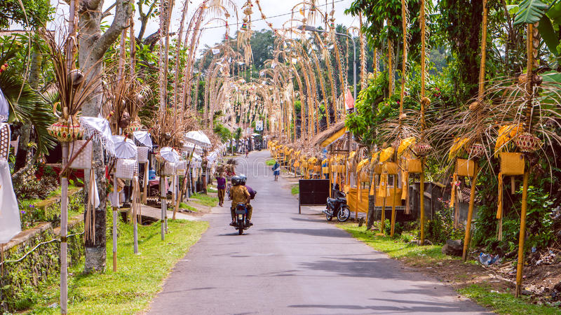 Bali Penjors, decorated bamboo poles along the village street in Sideman, Indonesia. royalty free stock photography