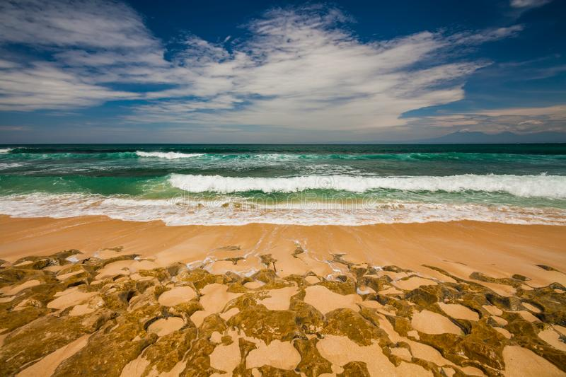 Bali seascape with huge waves at beautiful hidden white sand beach. stock photography