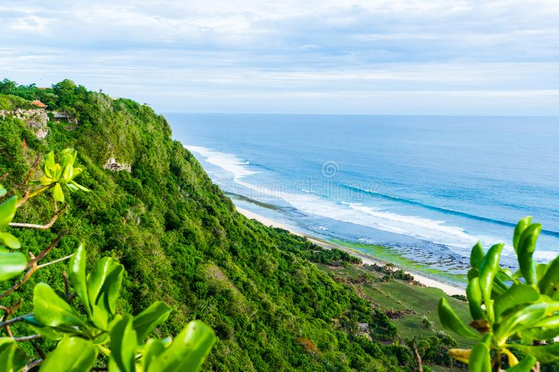 Bali seascape with huge waves at beautiful hidden white sand beach. Bali sea beach nature, outdoor Indonesia. Bali stock photography