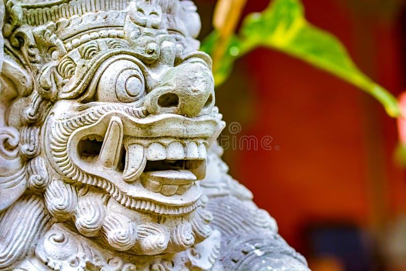 Bali statue of the gate guard Dwarapala royalty free stock photo