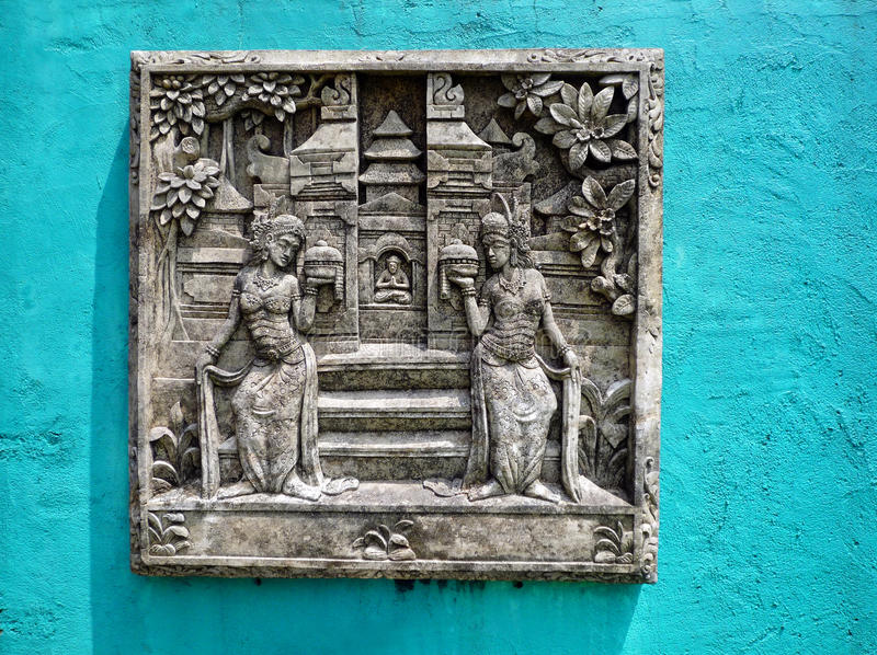 Bali stone carving stock image of balanced