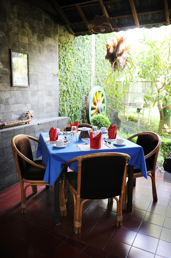 Bali style restaurant. A corner of Bali style restaurant royalty free stock photos