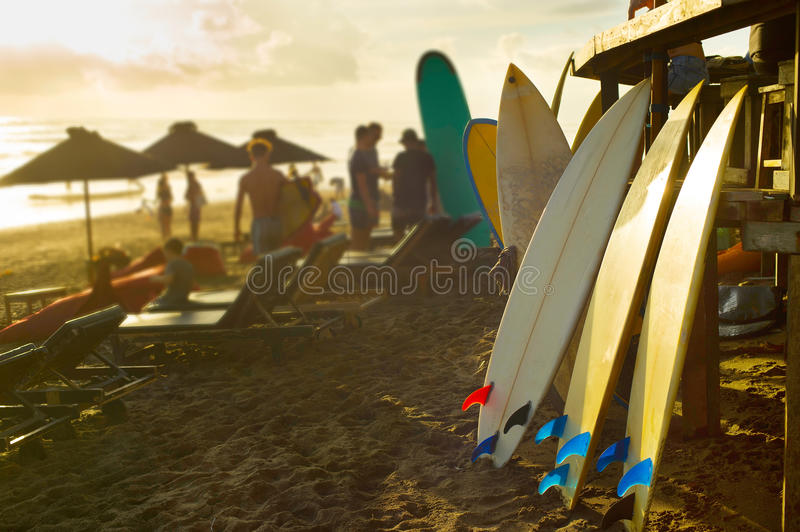 Bali surfers rental of surfboards. Surfboards for rent on Bali beach at sunset royalty free stock photos