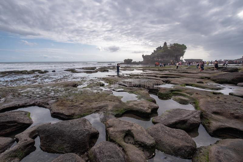 Bali Tourist take photo and sightseeing at Pura tanah lot temple famous place in Bali Indonesia. Bali , Indonesia-17 May 2018 : Tourist take photo and royalty free stock images