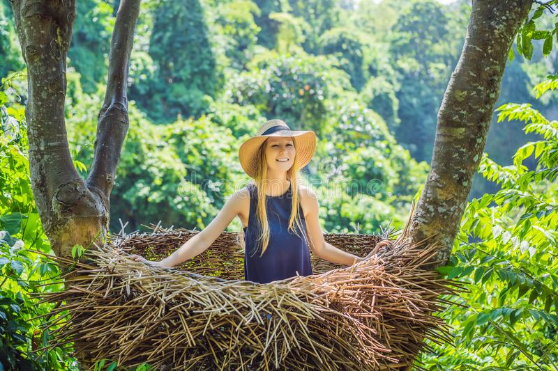 Bali trend, straw nests everywhere. Young tourist enjoying her travel around Bali island, Indonesia. Making a stop on a stock image