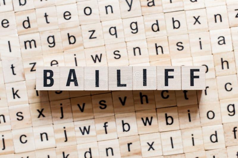 Baliff-Wortkonzept auf Würfeln stockfotografie