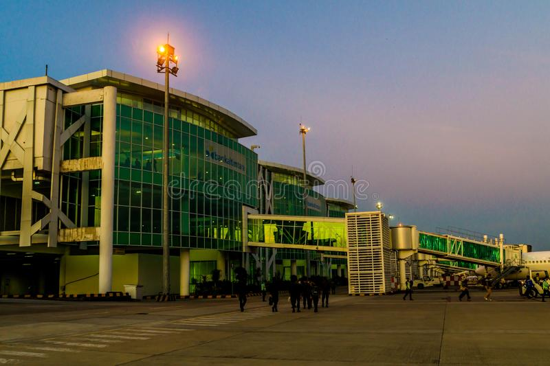 Balikpapan / Indonesia - 9/27/2018: The activity in the airport at dawn / dusk;. Boarding passengers, fueling, ground maintenance stock images