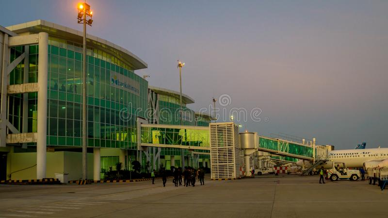 Balikpapan / Indonesia - 9/27/2018: The activity in the airport at dawn / dusk;. Boarding passengers, fueling, ground maintenance stock image