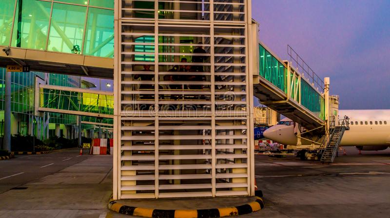 Balikpapan / Indonesia - 9/27/2018: The activity in the airport at dawn / dusk;. Boarding passengers, fueling, ground maintenance stock photo