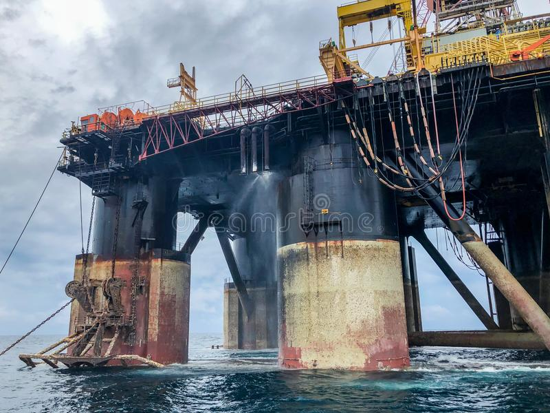 Semi submersible drilling rig view from crew vessel`s deck stock photos