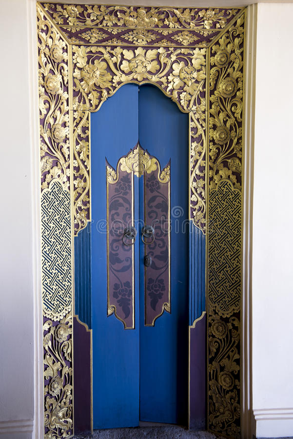 Balinese golden and blue luxury door stock images