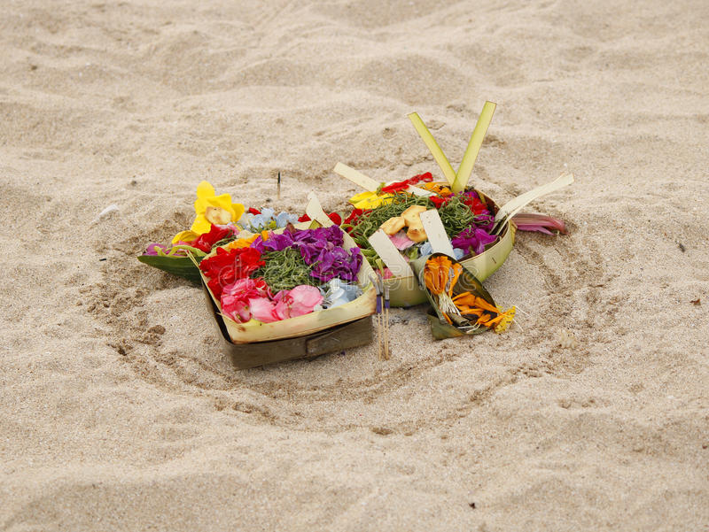 Balinese banten offerings. Traditional hindu banten offerings for gods made of the canang sari with flowers and other objects inside, Indonesia, Bali royalty free stock images