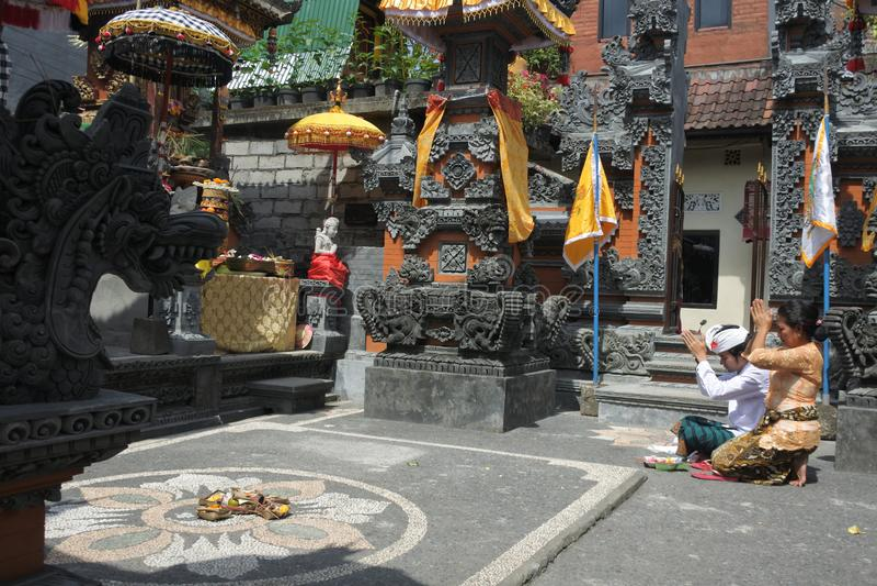 Balinese family celebrating Galungan Kuningan holidays in Bali Indonesia royalty free stock photos