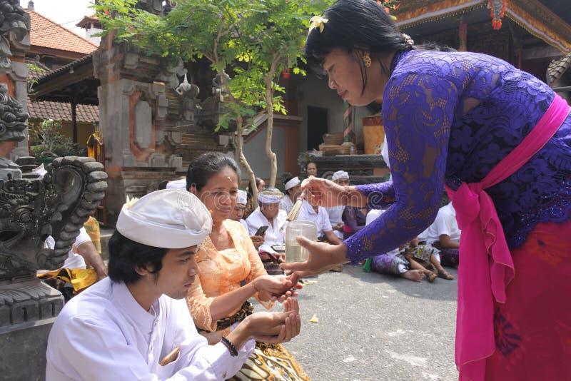 Balinese family celebrating Galungan Kuningan holidays in Bali Indonesia. Balinese family celebrating Galungan Kuningan holidays in a family temple in Ubud Bali royalty free stock photography