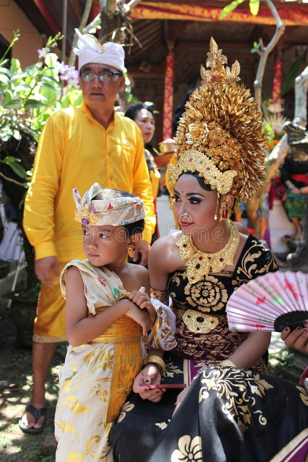 A Balinese girl and a small boy on Potong Gigi ceremony - Cutting Teeth - Cutting Teeth, Bali Island, Indonesia. A Balinese girl and a small boy on Potong Gigi stock photos