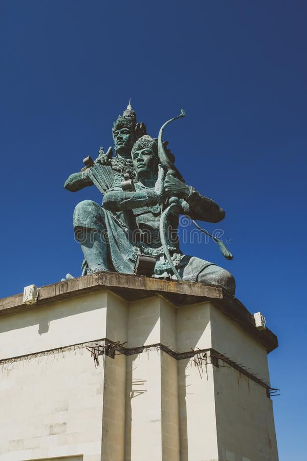 Balinese hindu statue over the blue sky royalty free stock photo