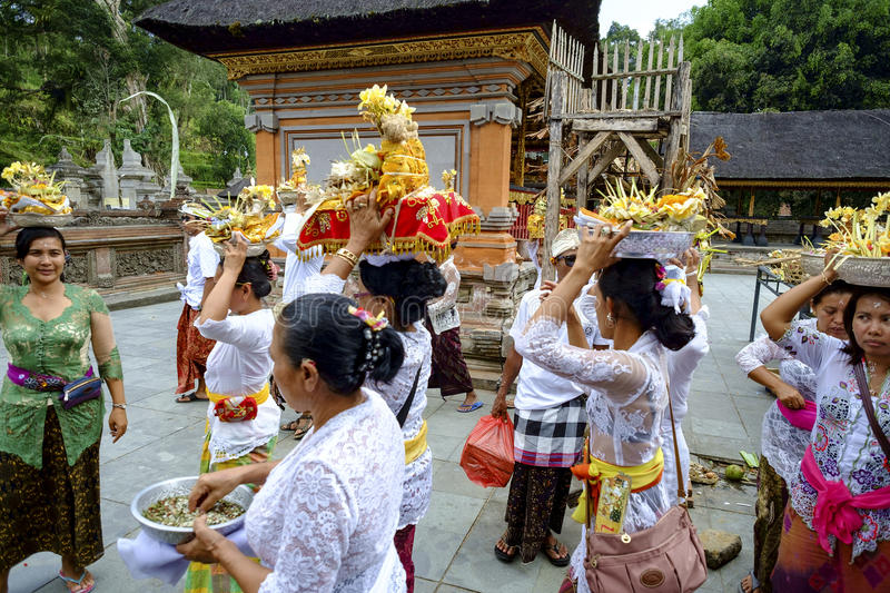 Balinese making preparation for praying stock photos