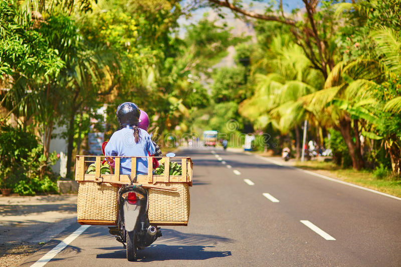 Balinese man on scooter stock image
