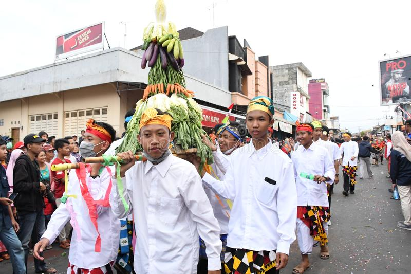Balinese men in traditional dress bringing offerings to Hindu temple, royalty free stock photo