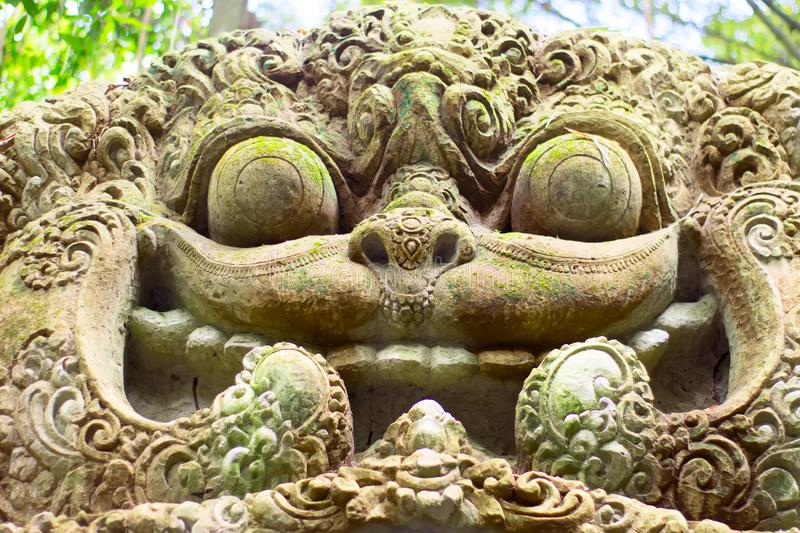 Balinese monsters that guard the entrance to many buildings on the island royalty free stock photo