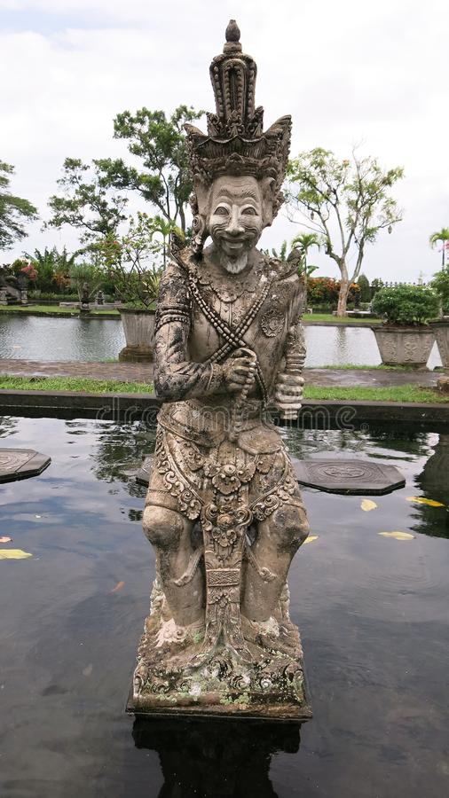 Balinese mythology protector and warrior statue. on Bali.Stone statue in tropical garden on Bali island. royalty free stock photo