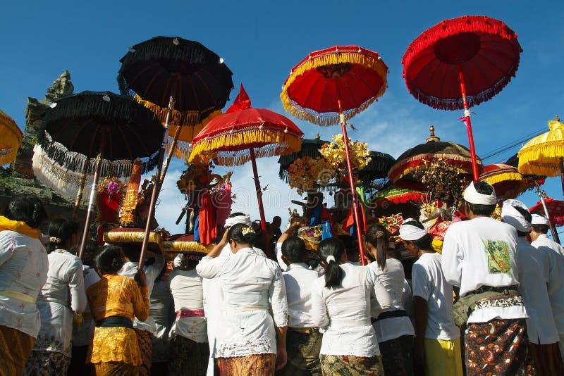Balinese pilgrim wearing  sarong ,during ceremony in Bali royalty free stock image