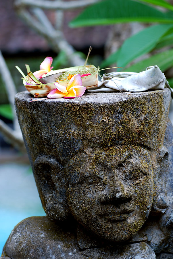 Balinese statue. Closeup of old Balinese statue stock image
