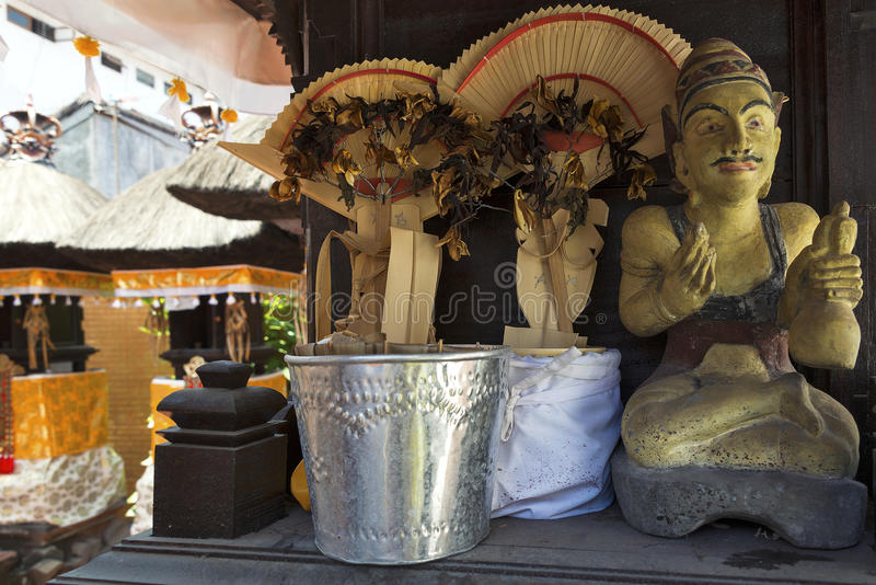 Balinese Temple Alter with Statue of Balinese Holy Priest. Decorations on a Balinese temple alter royalty free stock image