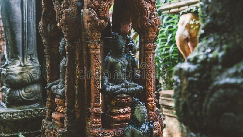 NBalinese traditional stone statues in the form of demons and gods close-up. Balinese traditional stone statues in the form of demons and gods close-up royalty free stock photography
