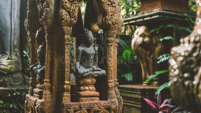 NBalinese traditional stone statues in the form of demons and gods close-up. Balinese traditional stone statues in the form of demons and gods close-up royalty free stock photos