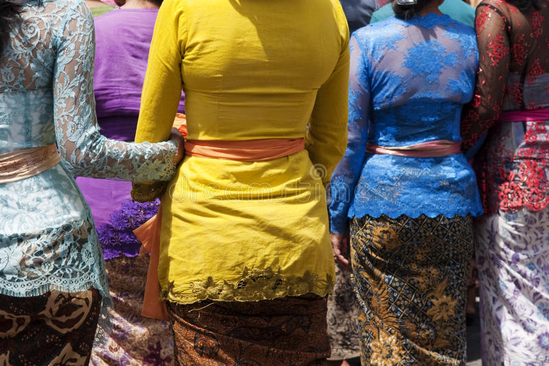 Balinese women. Rear view of Balinese women in traditional clothes royalty free stock photography