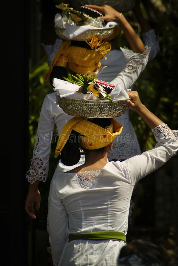 Balinese Women Bringing Offerings to a Hindu Cremation. royalty free stock photos
