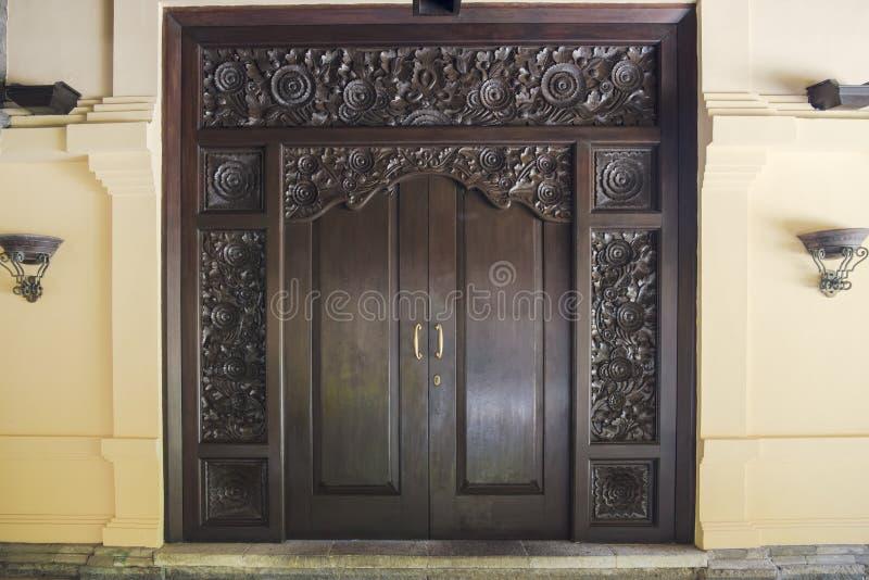 Balinese carved wooden elegant door stock photo