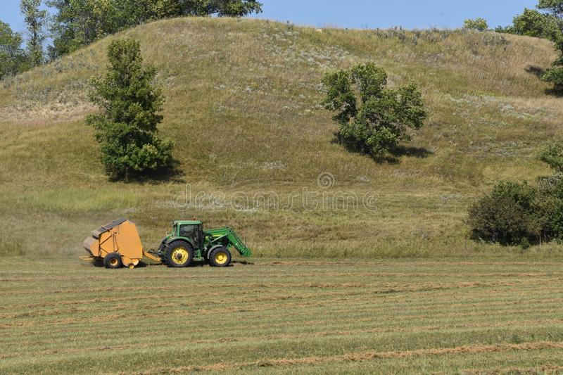 Baling hay on a hillside stock photo