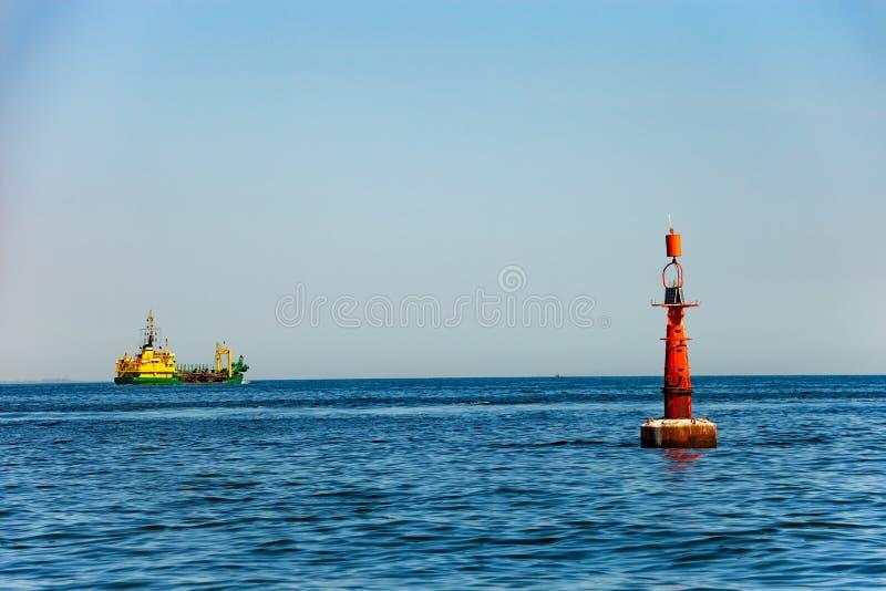 Balise sur la mer photographie stock