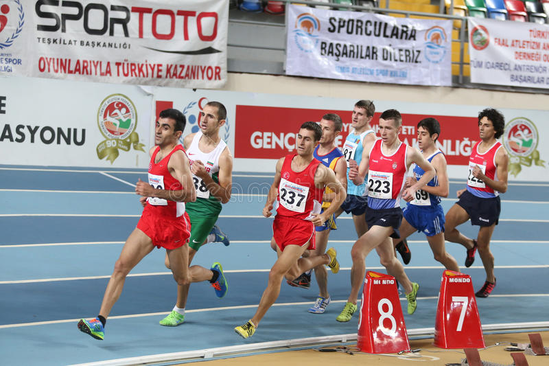 Balkan Athletics Indoor Championships. ISTANBUL, TURKEY - FEBRUARY 21, 2015: Athletes run during Balkan Athletics Indoor Championships in Asli Cakir Alptekin royalty free stock images