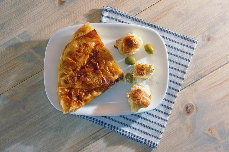 Balkan cuisine. Burek with cheese, national dish.  Flat lay. White rustic background stock images