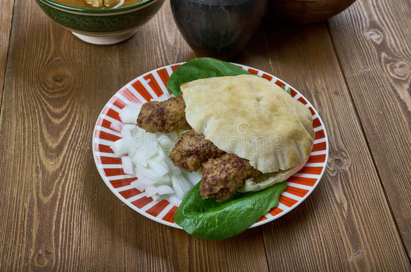 Balkans Cevapi. Cevapi - rilled dish of minced meat, a type of skinless sausage,traditionally in the countries of southeastern Europe,Balkans royalty free stock image