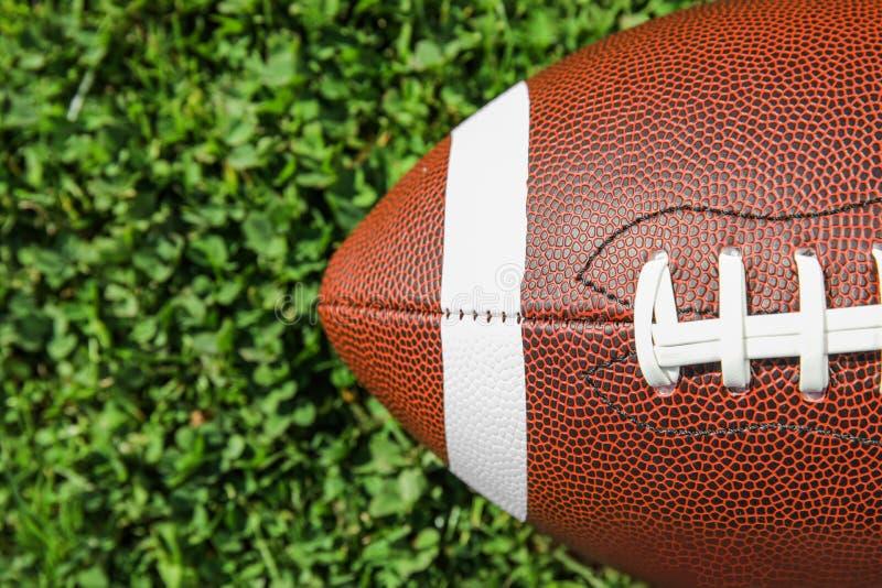 Ball for American football on fresh green field grass top view. Ball for American football on fresh green field grass, top view stock image