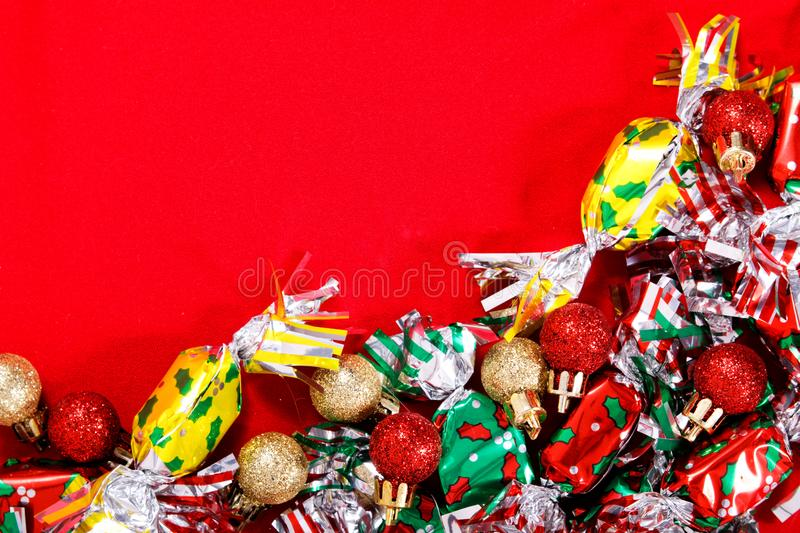 Ball background for Holiday party, new year, Christmas or Birthday Candy and Glitter ball on red background stock photos