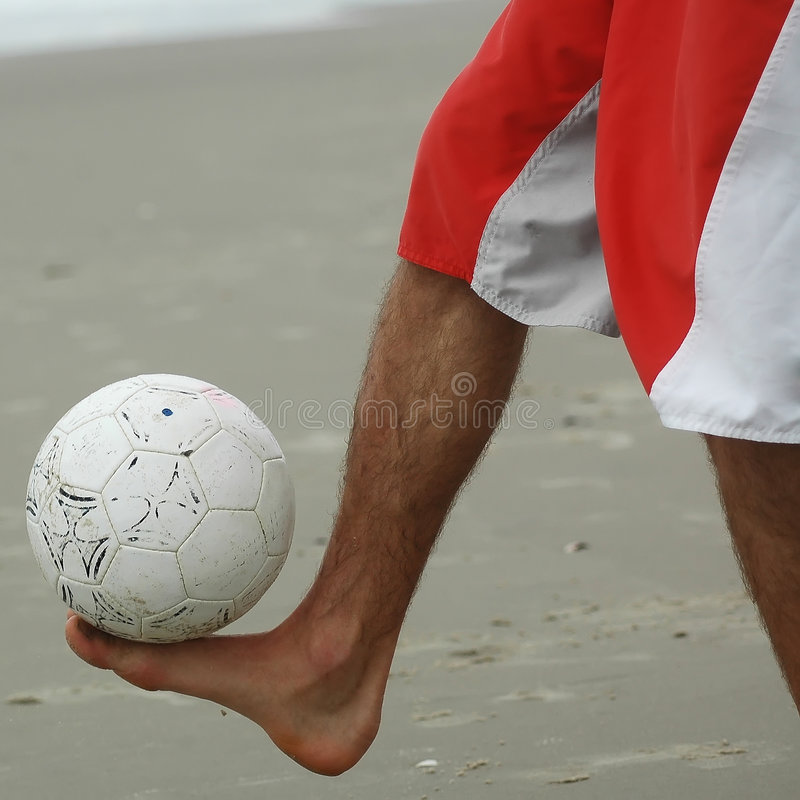 Ball balance above the foot. Right foot controlling a soccer ball royalty free stock photo