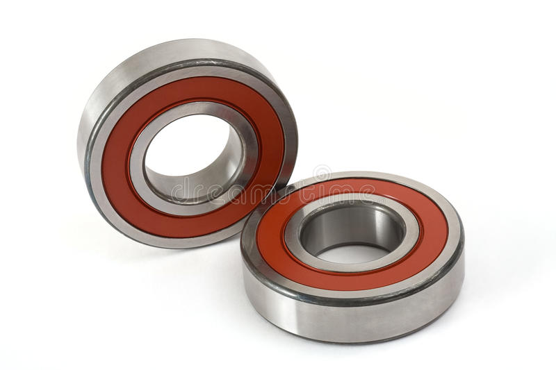 Ball-bearings. Two ball-bearings on a white background stock image