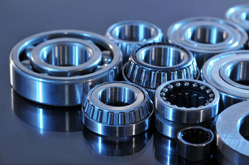 Ball-bearings. Closeup view of several ball-bearings in blue light stock photography