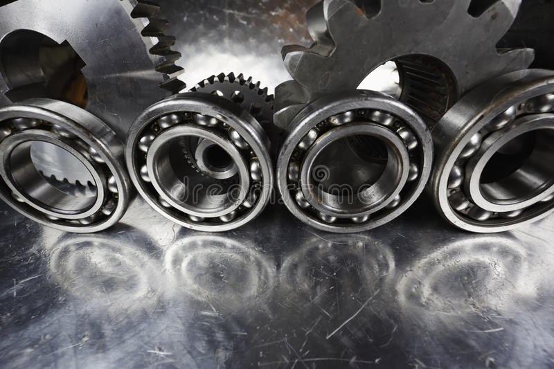 Ball-bearings and gear parts. Titanium bearings and gears, aerospace industrial parts stock photos