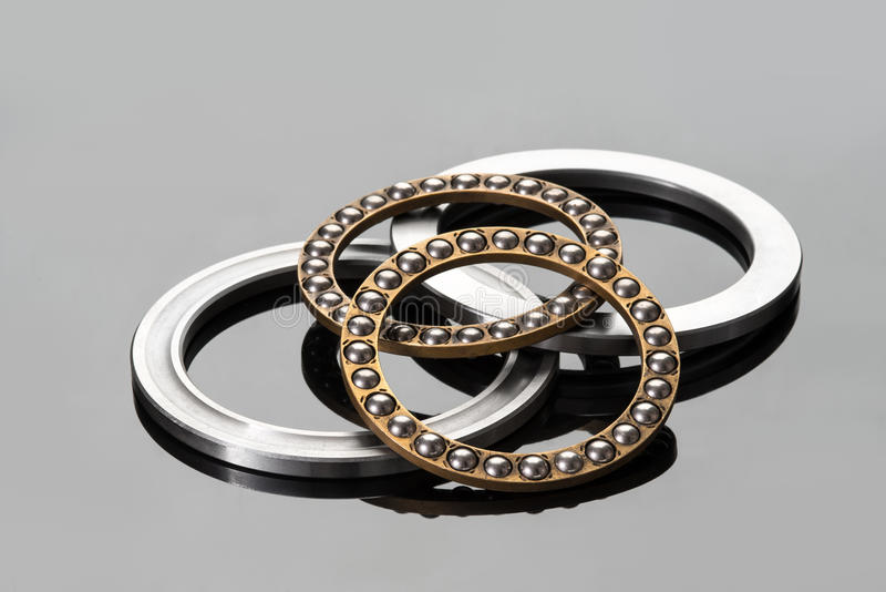 Ball bearings. On grey with reflection stock images