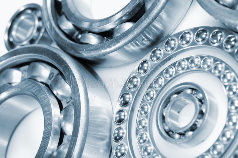 Ball bearings, pinions against whites royalty free stock photo